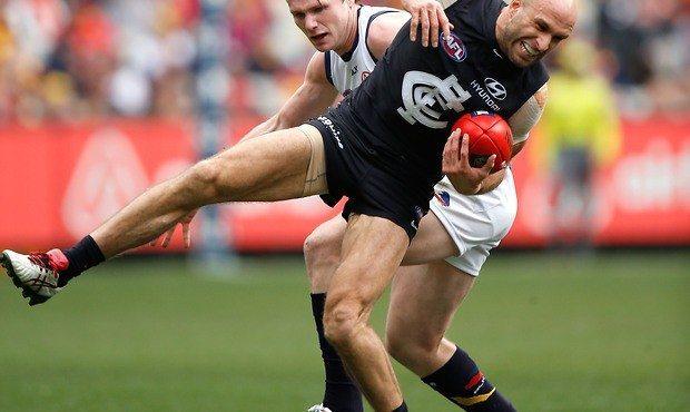 Chris Judd injures his knee on Saturday afternoon against Adelaide. Source: AFL Media.