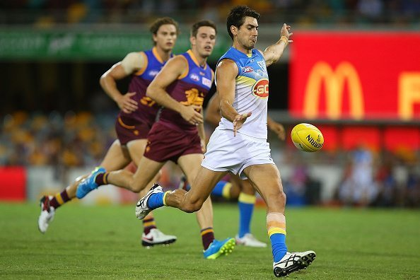 BRISBANE, AUSTRALIA - APRIL 16: Matt Rosa of the Suns kicks during the round four AFL match between the Brisbane Lions and the Gold Coast Suns at The Gabba on April 16, 2016 in Brisbane, Australia. (Photo by Chris Hyde/Getty Images)