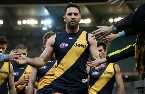 MELBOURNE, AUSTRALIA - JULY 25: Troy Chaplin of the Tigers leads the team off the field after his 200th game during the 2015 AFL round 17 match between the Richmond Tigers and the Fremantle Dockers at the Melbourne Cricket Ground, Melbourne, Australia on July 25, 2015. (Photo by Adam Trafford/AFL Media/Getty Images)