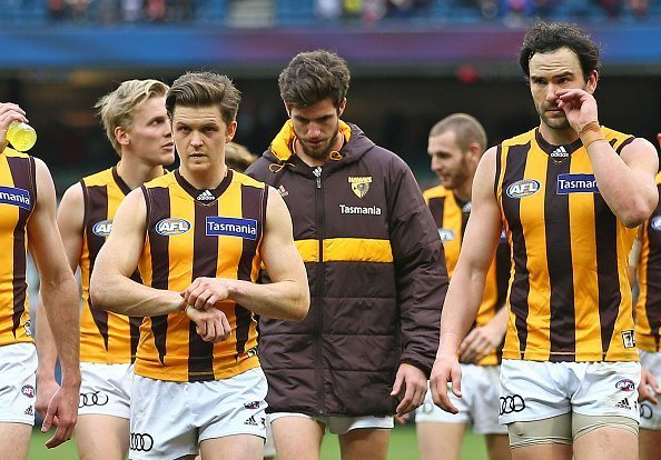 MELBOURNE, AUSTRALIA - AUGUST 06: Ben Stratton and the Hawks leave the field after losing the round 20 AFL match between the Melbourne Demons and the Hawthorn Hawks at Melbourne Cricket Ground on August 6, 2016 in Melbourne, Australia. (Photo by Scott Barbour/Getty Images)