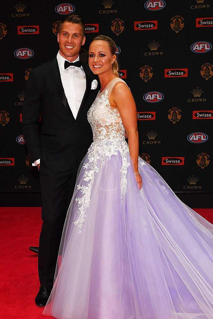 MELBOURNE, AUSTRALIA - SEPTEMBER 26: Andrew Swallow of North Melbourne (L) and wife Elise Swallow arrive ahead of the 2016 Brownlow Medal at Crown Entertainment Complex on September 26, 2016 in Melbourne, Australia. (Photo by Quinn Rooney/Getty Images)